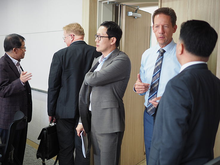 The participants conversing during the break